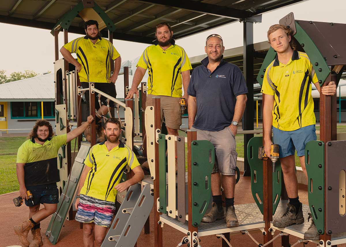 NT Sports and Playgrounds staff on a playground they built